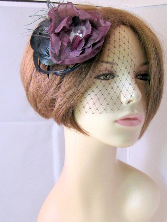 Purple floral pin with birdcage veil