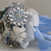 Pale blue brooches