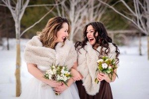 rustic winter shoot with woodsman details - Bride and Bridesmaid