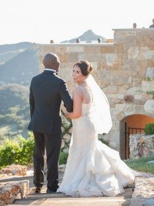 A Stunning Elegant Wedding in Malibu - Bride Looking Over Her Shoulder and Laughing