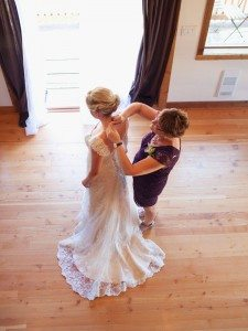 A Lovely Rustic Barn Wedding in British Columbia - Mother Putting Necklace on Bride