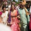 A Colourful and Glamorous Indian Wedding - Bride Walking Down Aisle