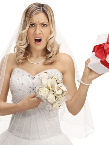 Worst Wedding Gifts Ever - Unhappy Bride Holding Present