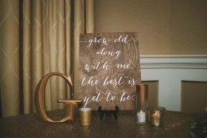 green wedding with gold accents in new brunswick - signage