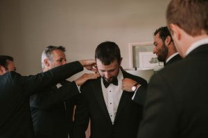 green wedding with gold accents in new brunswick - groom