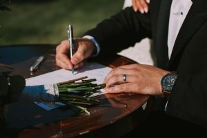 green wedding with gold accents in new brunswick - signing marriage certificate