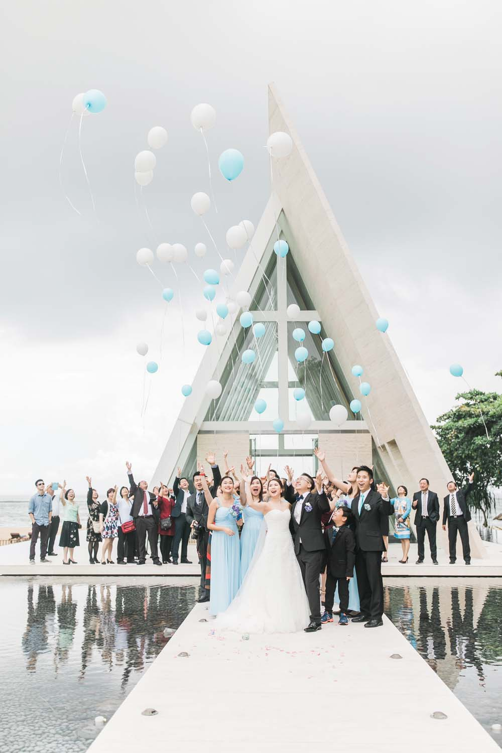 a dreamy destination wedding in bali - bride and groom with wedding party