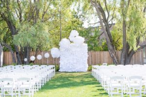 a cottage-chic summer wedding - ceremony backdrop