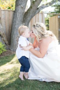 a cottage-chic summer wedding - bride and son