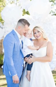 a cottage-chic summer wedding - bride and groom with son