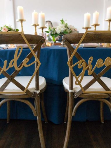 An Intimate Gold & Navy Wedding In British Columbia - bride and groom chairs