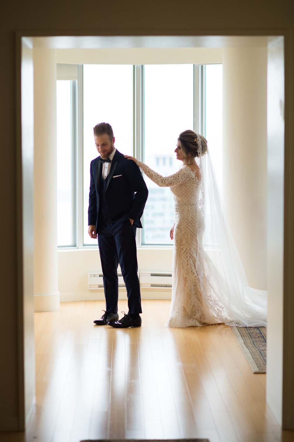 A Classic Vintage inspired Wedding at the One King West in Toronto - Groom turning to see Bride