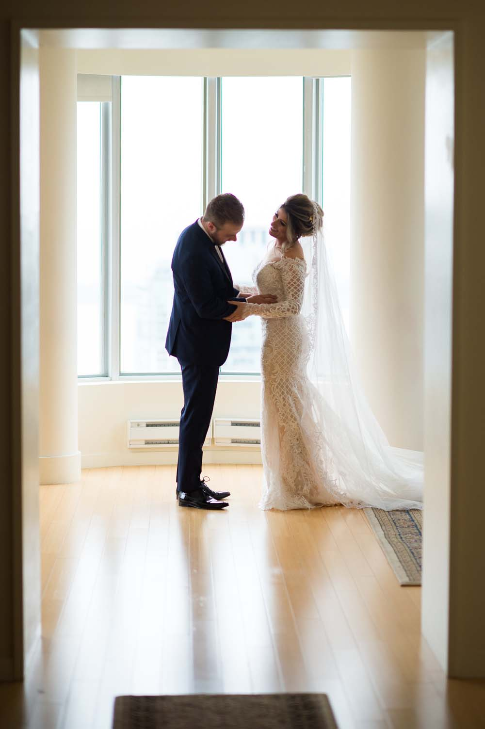 A Classic Vintage inspired Wedding at the One King West in Toronto - Groom seeing Bride for First Time