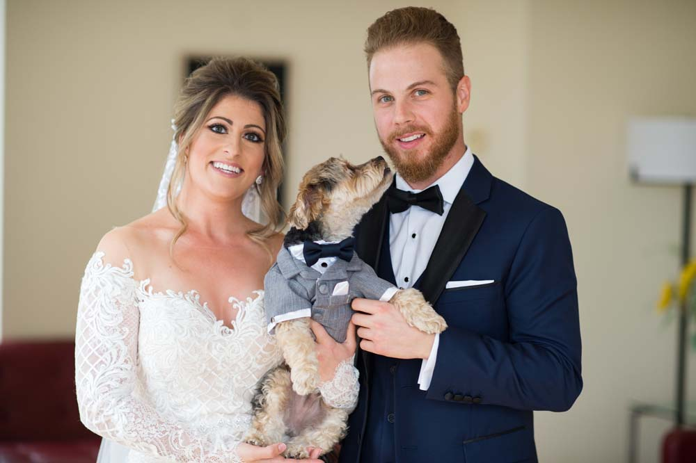 A Classic Vintage inspired Wedding at the One King West in Toronto - Bride and Groom Posing with Dog