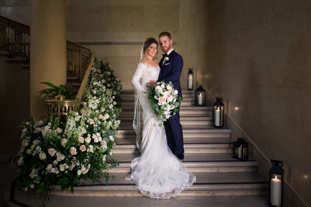 A Classic Vintage inspired Wedding at the One King West in Toronto - Bride and Groom Pose on Stairs