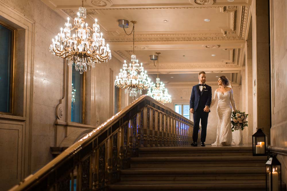 A Classic Vintage inspired Wedding at the One King West in Toronto - Happy Couple Holding Hands