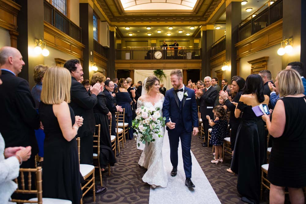 A Classic Vintage inspired Wedding at the One King West in Toronto - Couple Walks Down the Aisle