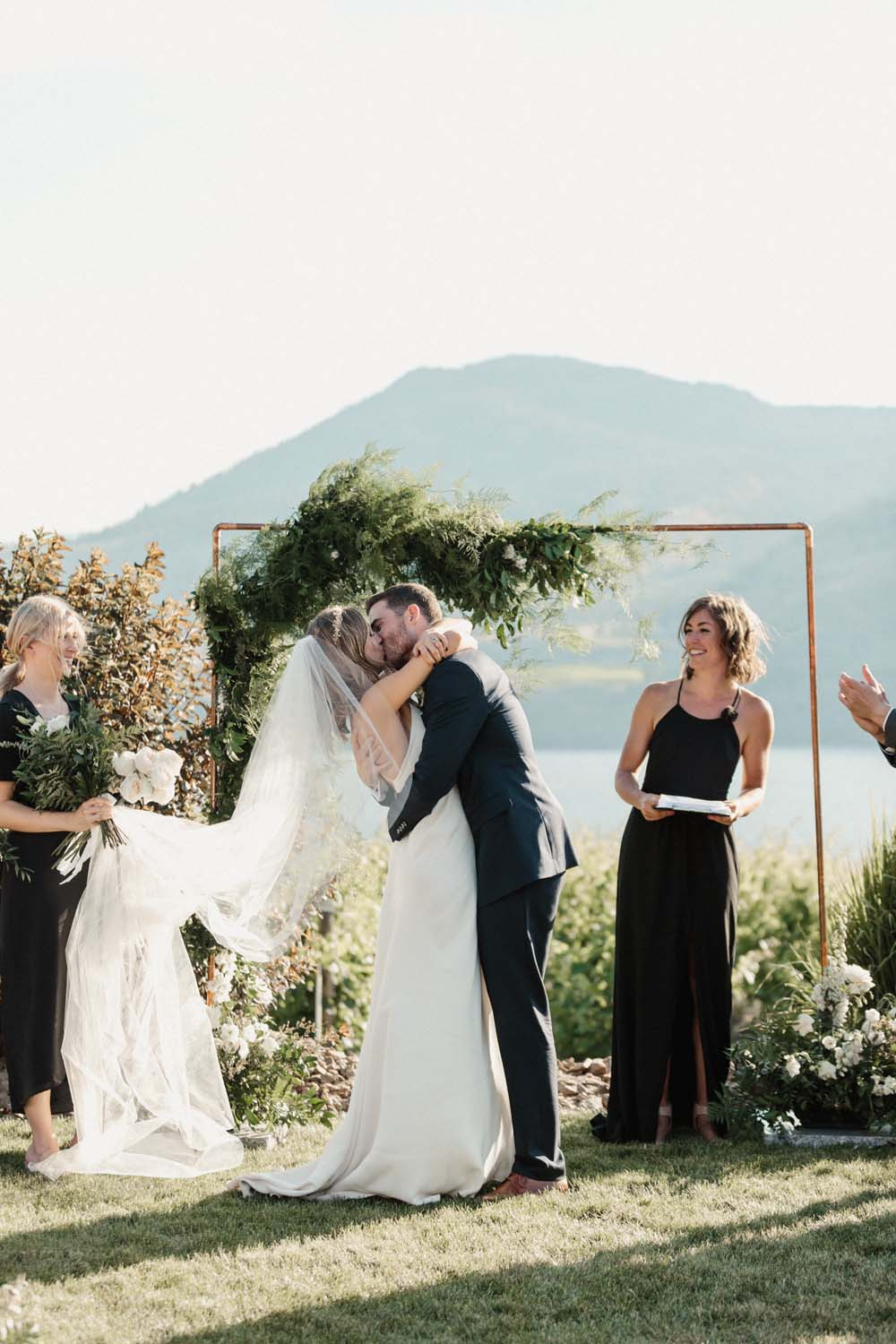 Jill Lansky of The August Diaries' Modern-Chic Wedding In British Columbia - ceremony kiss