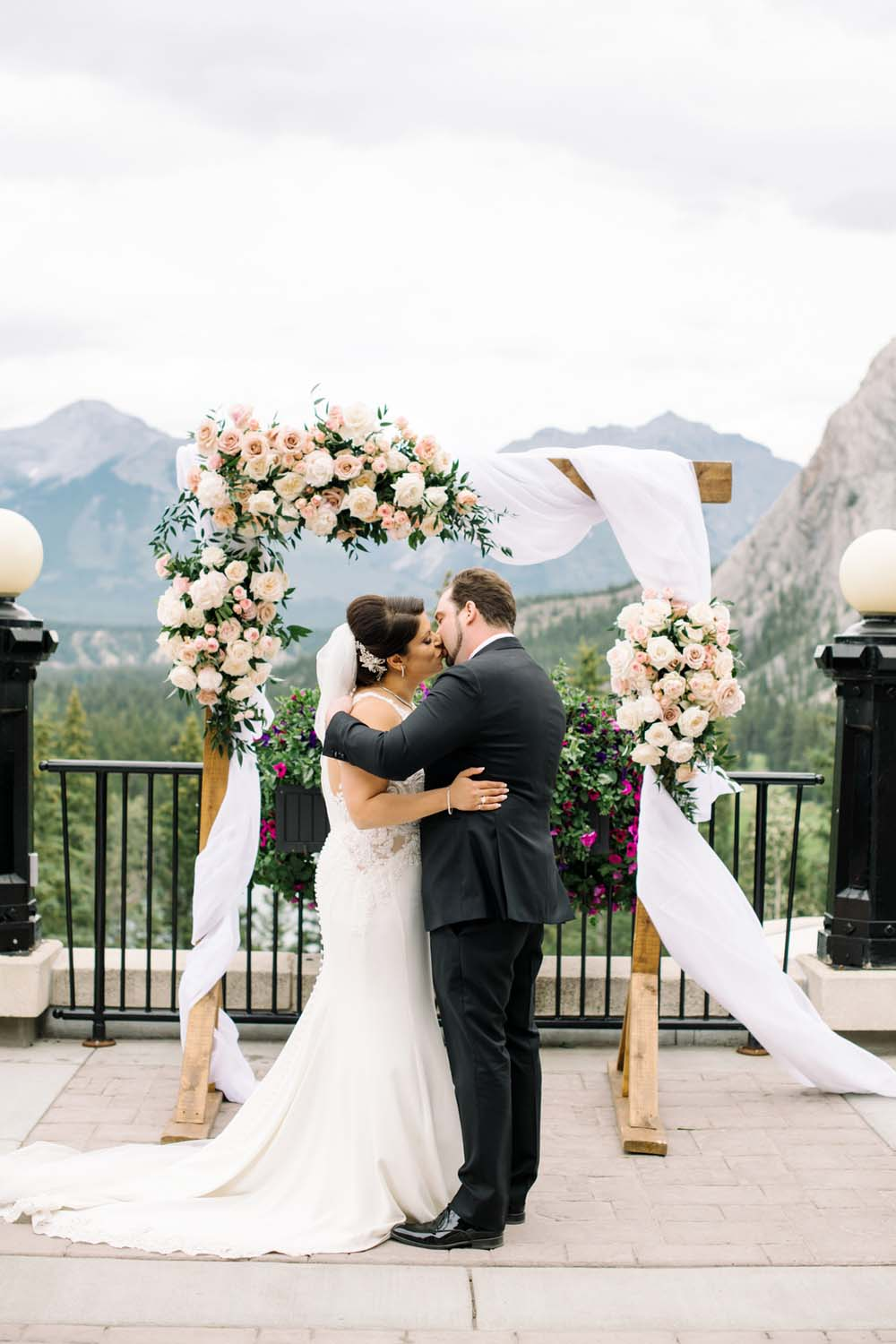 A Regal Fairytale Wedding in Banff, Alberta - Kiss