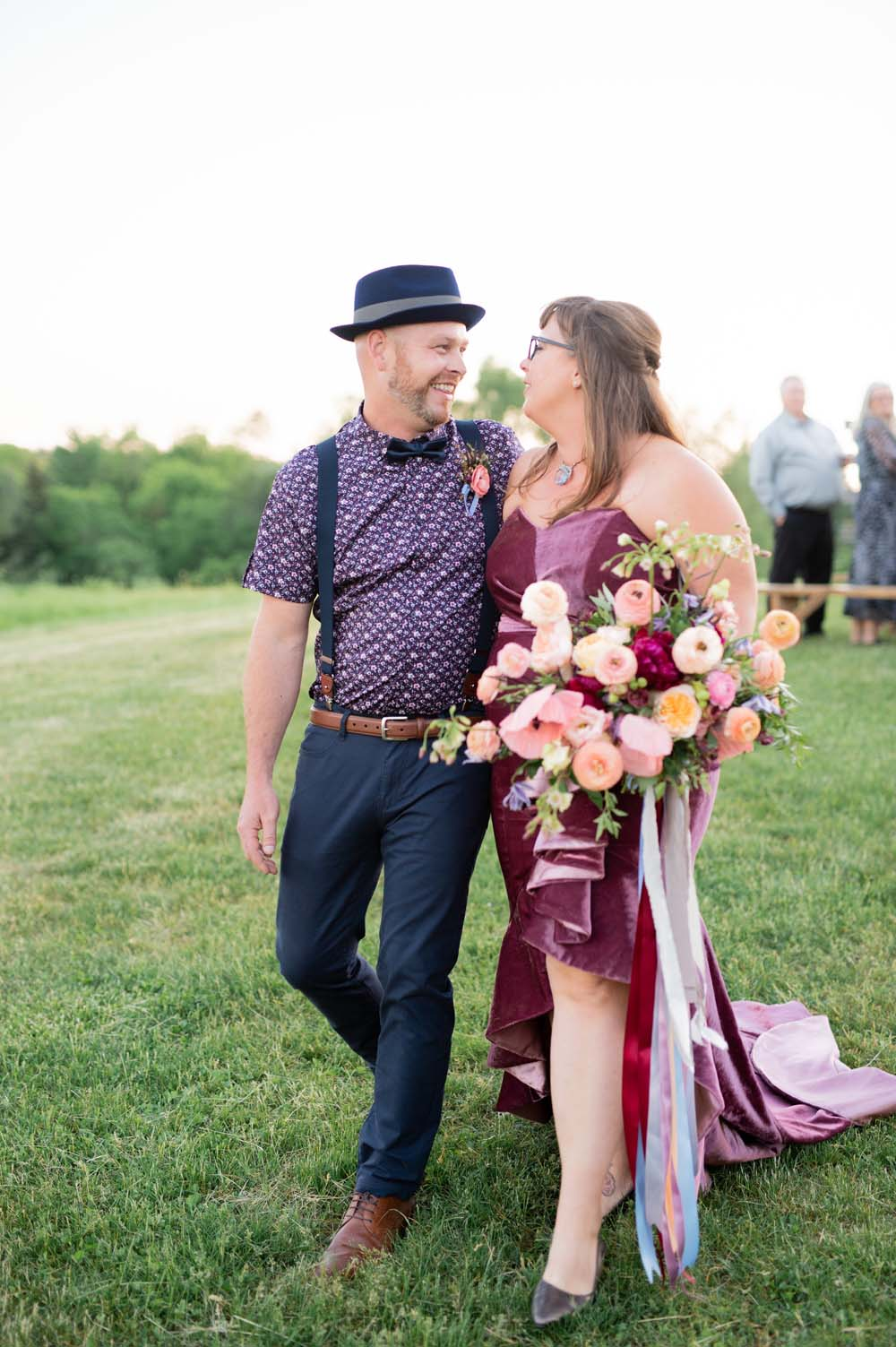 A Quirky Non-Traditional Wedding in Kitchener, Ontario - Couple in grass
