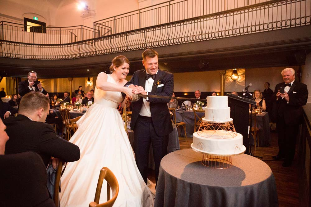 A Modern Wedding At The Great Hall In Toronto - cutting cake