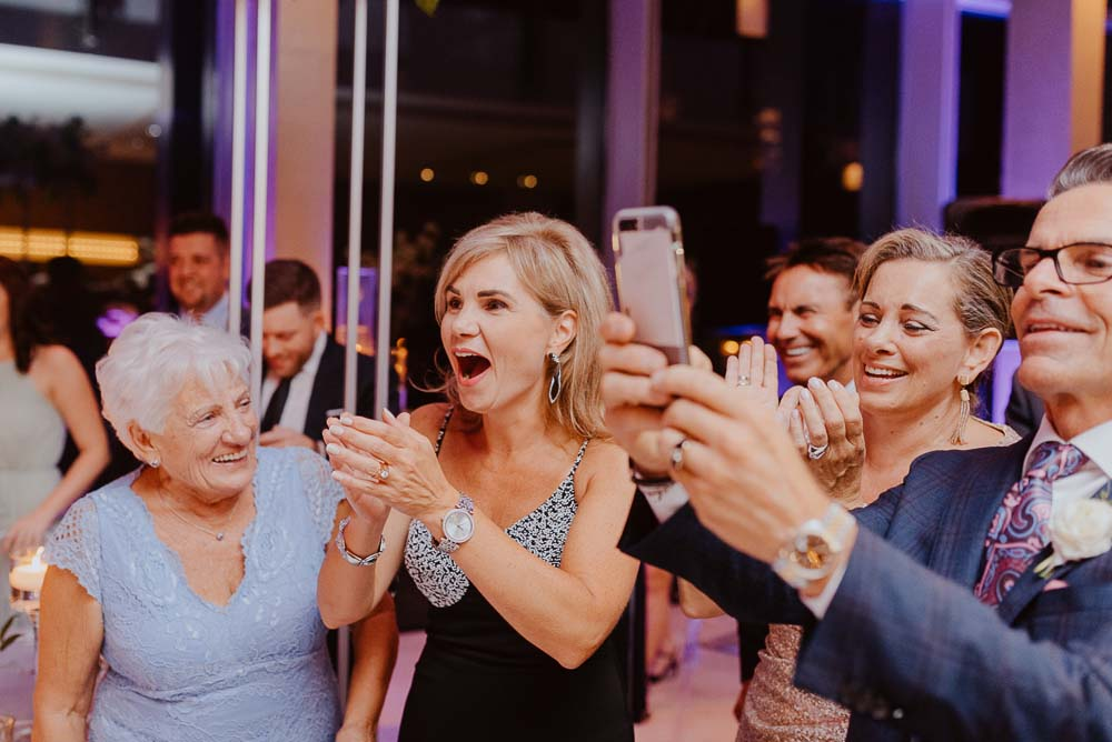 An Opulent Wedding At The Royal Conservatory Of Music - phone