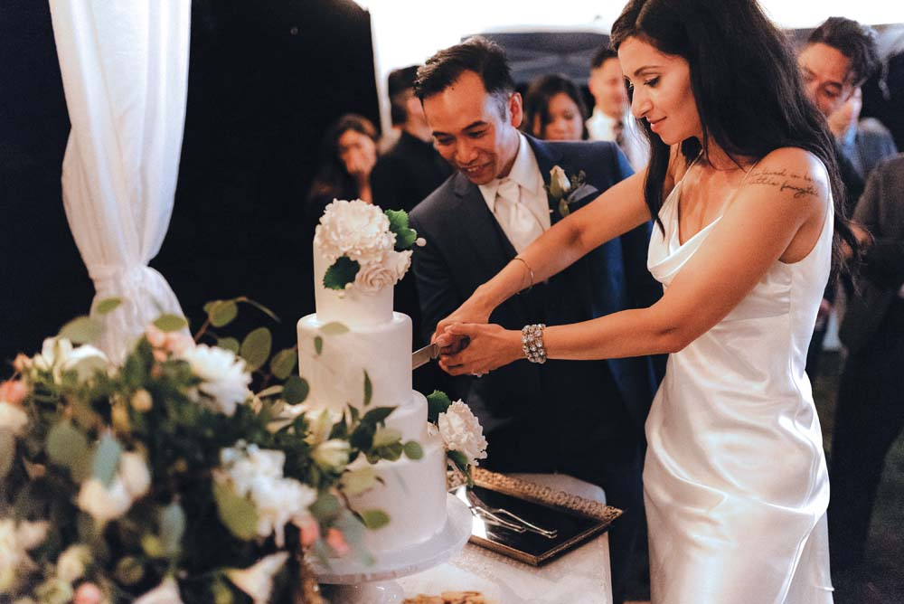 A Multicultural Wedding At The UBC Botanical Garden in Vancouver - cake-cutting