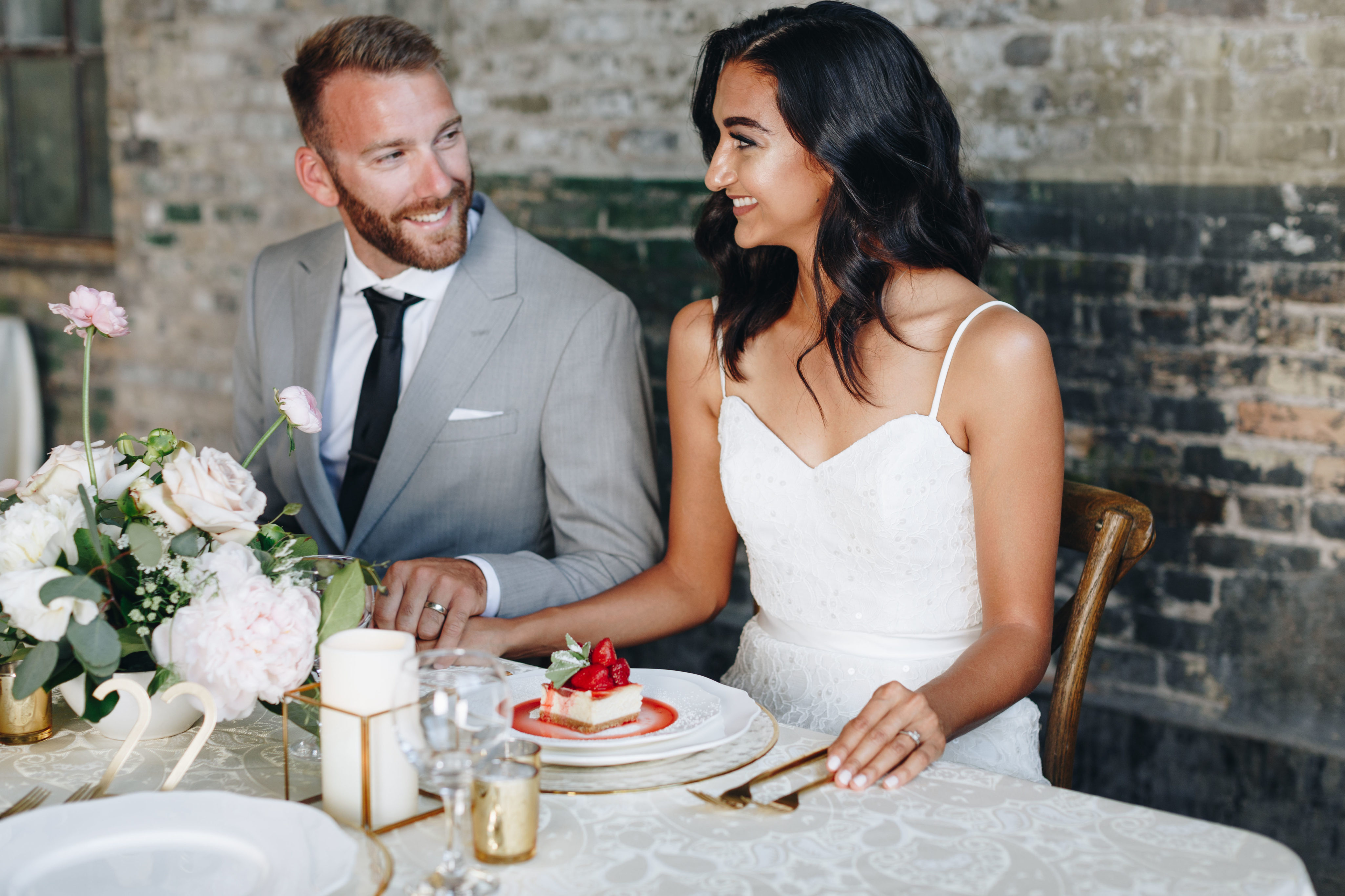 Bride and Groom sit with their dessert